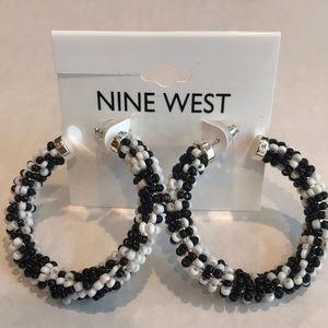 Nine West Brand New large hoop earrings.